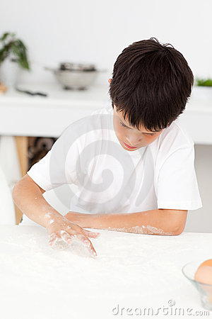 Free Cute Boy Playing With Floor While Cooking Alone Stock Photo - 17279170