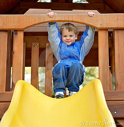 Cute boy preparing to slide.