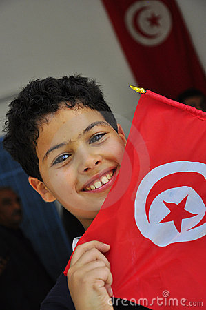 Cute boy with red tunisian flag Editorial Stock Photo