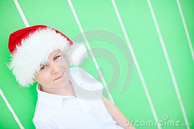 Cute boy in a Santa hat