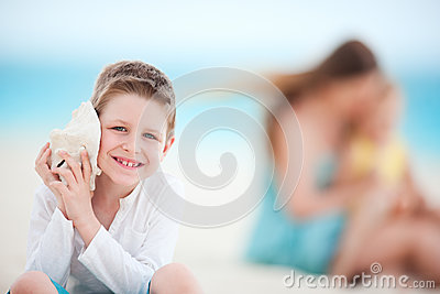 Cute boy with seashell