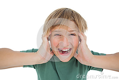 Cute boy shouting and covering his ears