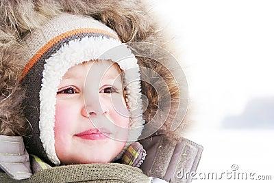 Cute boy in snowsuit