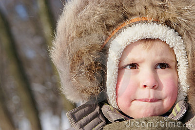 Cute boy in snowsuit
