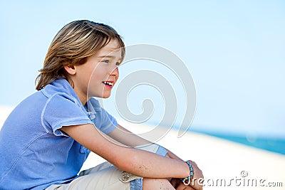 Cute boy staring at sea.
