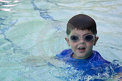 Cute boy with swimming goggles