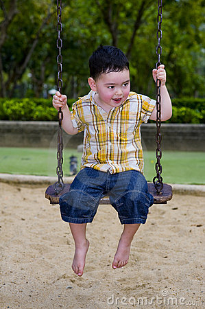 Cute boy on a swing