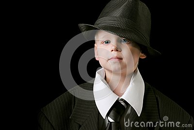 Cute boy with tie and hat