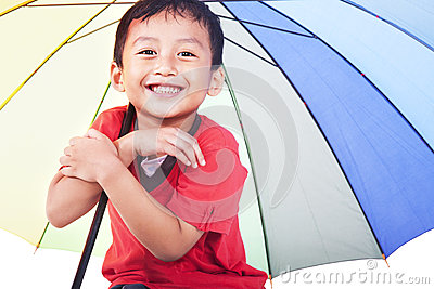 Cute boy under umbrella