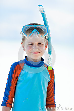 Cute boy wearing mask and snorkel