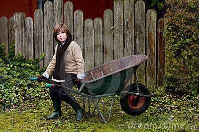 Cute boy and wheelbarrow
