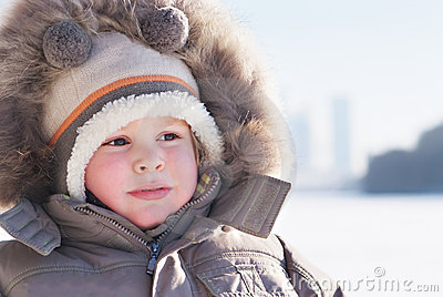 Cute boy in winter clothes