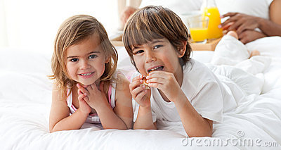 Cute brother and sister having breakfast