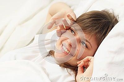 Cute brunette in bed