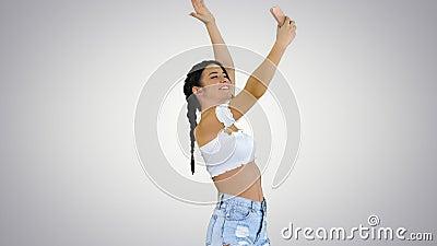 Cute brunette girl takes a selfie and dancing on gradient background. Medium shot. Cute brunette girl takes a selfie and dancing on gradient background stock footage