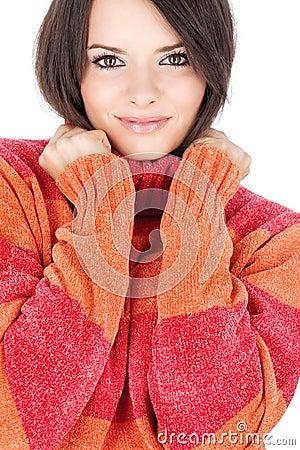 Cute brunette in a red-orange wool sweater
