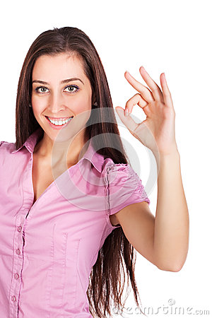 Cute brunette is  showing hand sign ok