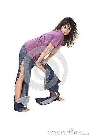 Cute brunette in tear jeans