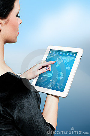 Cute brunette using interface of new touch pad dev