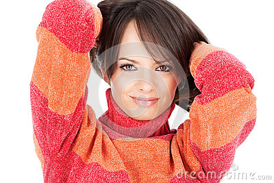 Cute brunette woman in a red-orange wool sweater