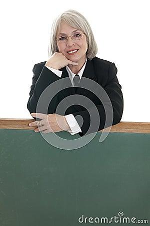 Cute business woman with blank chalkboard