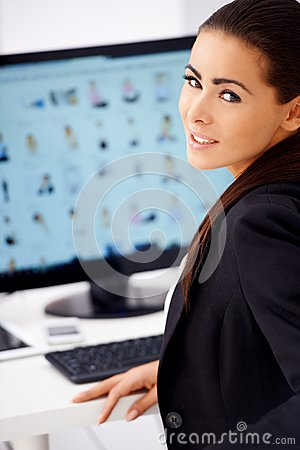 Cute business woman sitting in front of computer