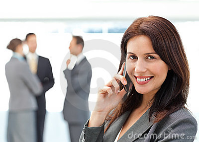 Cute businesswoman on the phone