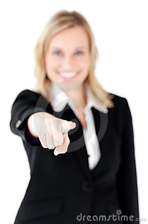 Cute businesswoman pointing at camera with finger