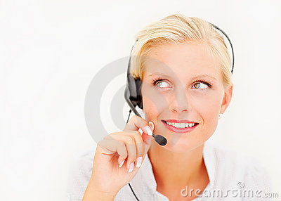 Cute call centre employee looking away