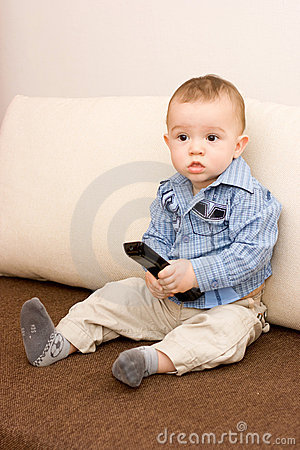 Cute caucasian boy with tv console