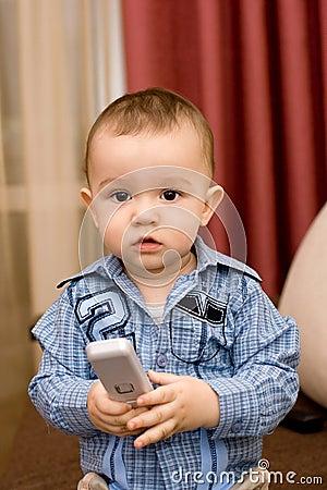 Cute caucasian boy with tv console