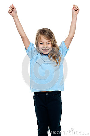 Cute caucasian girl celebrating with raised arms