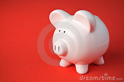 Cute Ceramic Piggy Bank on Red Background