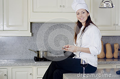 Cute chef taking break for texting