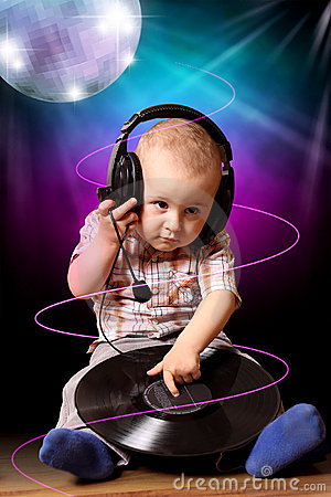 Cute child baby dj in disco