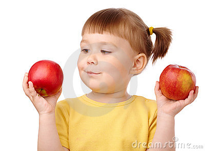 Cute child choose between two apples