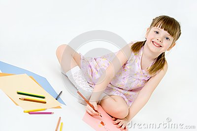 Cute child draw with colorful crayons and smile