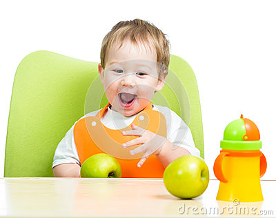 Cute child eating apples, isolated on white