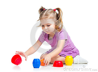 Cute child girl playing with toys
