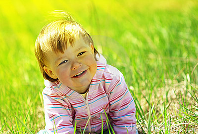 Cute child having fun on the meadow