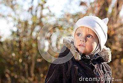 Cute child looks upward directed