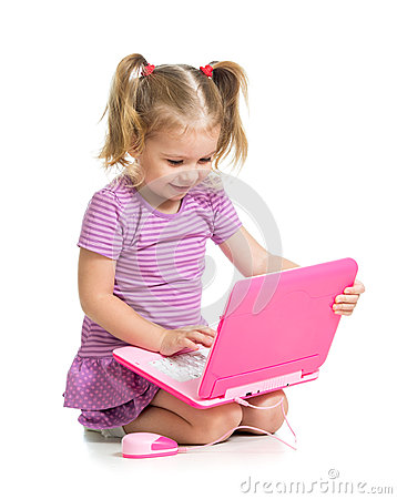 Cute child playing on laptop on white background