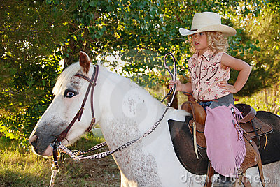 Cute child on a pony.