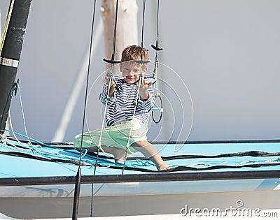 Cute child on sea catamaran / yacht