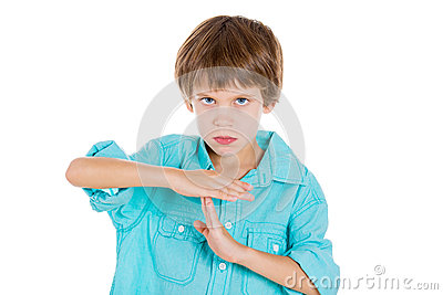 Closeup portrait of adorable kid making a time out sign with his hands