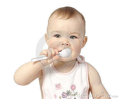 Cute child with spoon