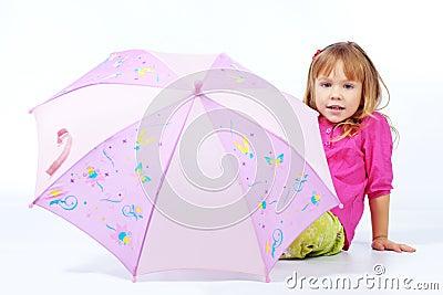 Cute child with umbrella
