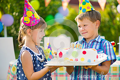 Cute children in love holding cake