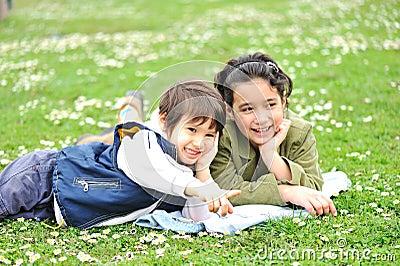 Cute children on meadow