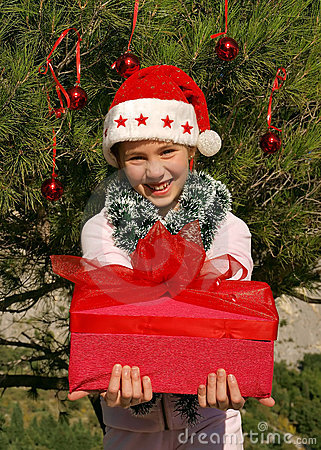 Cute Christmas girl giving a gift 1